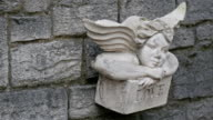An angel sculpture on the wall of a church video