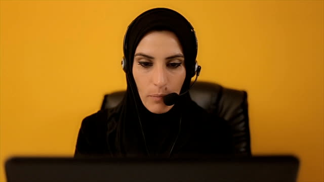 An Arab business woman has an online conference with business partners video