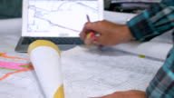 DS An architect working with blueprints video