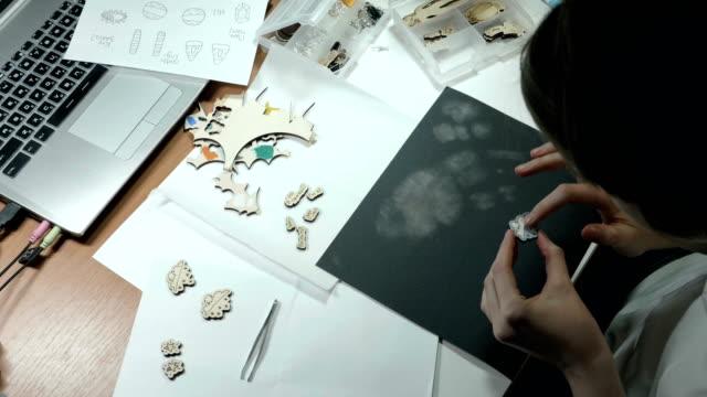 An artist grinds wooden craft on sandpaper video