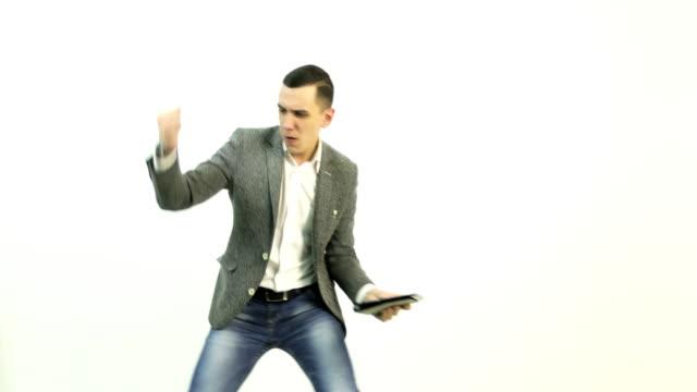 4K An energetic businessman is dancing. video