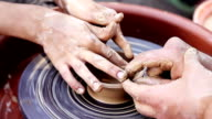 an experienced potter craft teaches boys video
