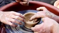 an experienced potter craft teaches boys video