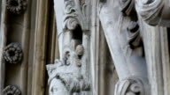 An image of the faces sculpted on the wall of Westminster Abbey video
