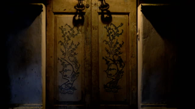 An old door with large handles and a in a vintage style. video