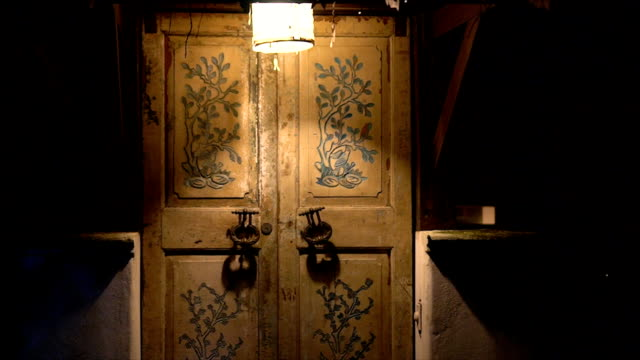 An old door with large handles and a keyhole in a vintage style. video