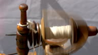 An old spinning wheel fastly turning around GH4 video