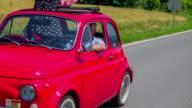 An older couple enjoying a car ride video