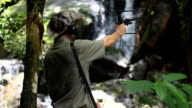 An ornithologist using radio telemetry,tracking to find an wildlife in tropical rainforest video
