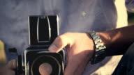 Analog photographer on street video