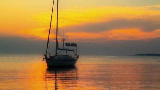 HD: Anchored Sailboat At Sunset video