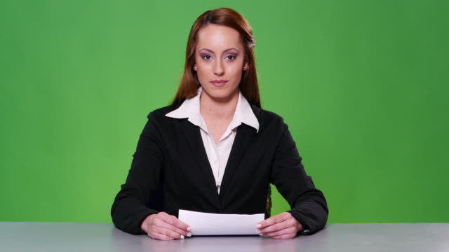 4K Anchorwoman with black suit on green background video