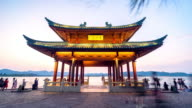 ancient architecture by west lake of hangzhou. timelapse day to night video