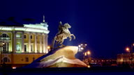 Ancient Bronze Horseman statue in snowy night time, winter in Saint Petersburg video