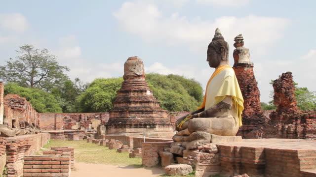 Ancient buddha statue and pagoda. video