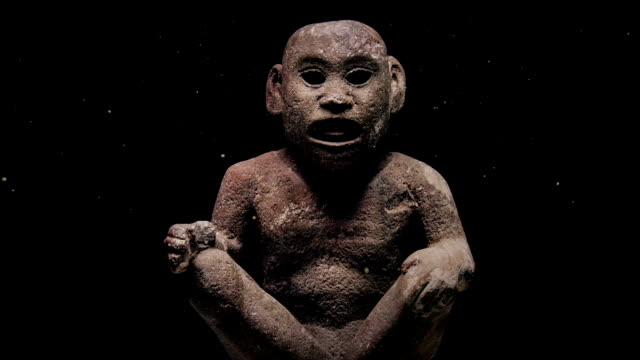 Ancient Carved Figure With Dust Floating Around video