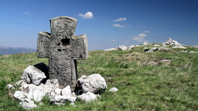 Ancient cross on a hill video
