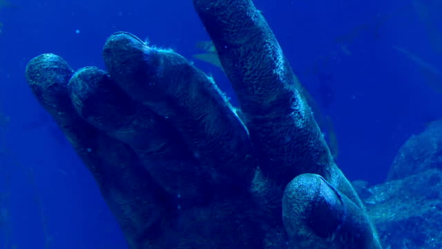 Ancient Hand Statue In The Ocean video