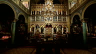 Ancient iconostasis in the old christian church. General view video