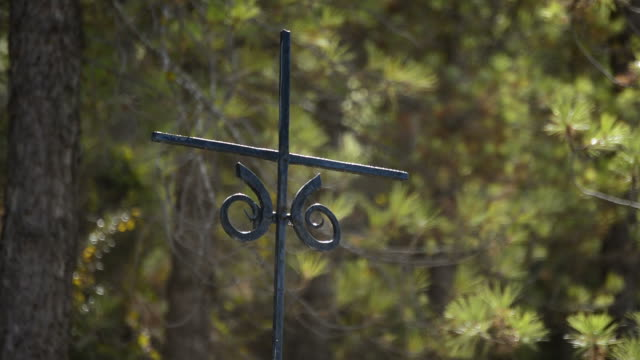 Ancient spanish iron cross in a road of a village of andalusia video