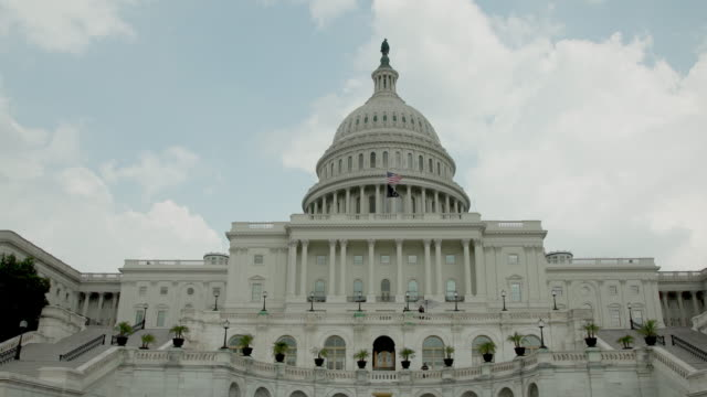 POW MIA and American Flags at the U.S. Capitol Building in Washington, DC - Zoom in 4k/UHD video