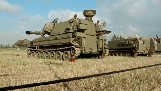 HMMWV and tanks in summer field video