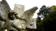 Angel statue and cross, with camera move. video
