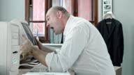SLO MO Angry business man screaming at computer screen video