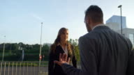 SLOW MOTION CLOSE UP: Angry businessman and businesswoman arguing outdoors video