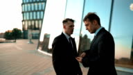 Angry businessman grabs by the lapels his boss video