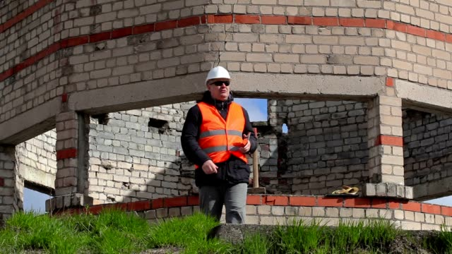 Angry Civil engineer talking and using tablet PC video