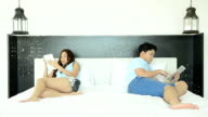Angry Couple On The Bed And Using Tablet video