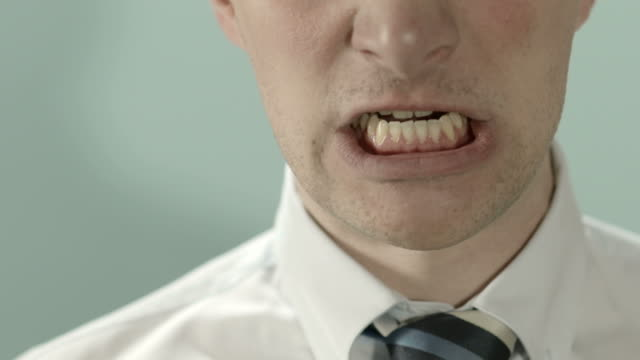Angry man shouting at camera. Close up video