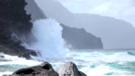 SLOW MOTION: Angry waves splashing into big ocean cliff rising out of the sea video