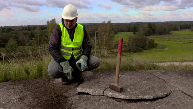 Angry worker talking near broken concrete slabs video