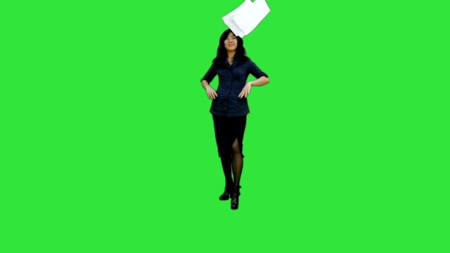 Angry young businesswoman tearing paper on a Green Screen, Chroma Key video
