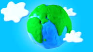 Animated Earth with clouds, loop.  Stop motion video