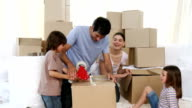 Animated parents and their children moving house video