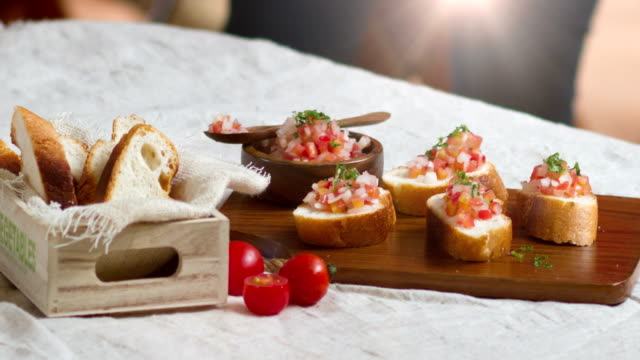 2.5D Animation Delicious vegetarian appetizer of bruschetta with tomatoes. video