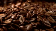 Animation video of falling coffee beans in slow motion video