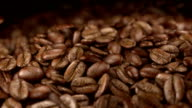 Animation video of falling offee beans in slow motion video