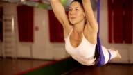 Anti-gravity Yoga, woman doing yoga exercises indoor video