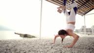 Anti-gravity Yoga, woman doing yoga exercises video