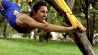 Anti-gravity Yoga, woman doing yoga exercises with hammock in the park video
