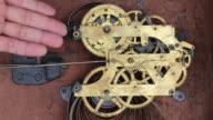 Antique clock winding mechanism. video