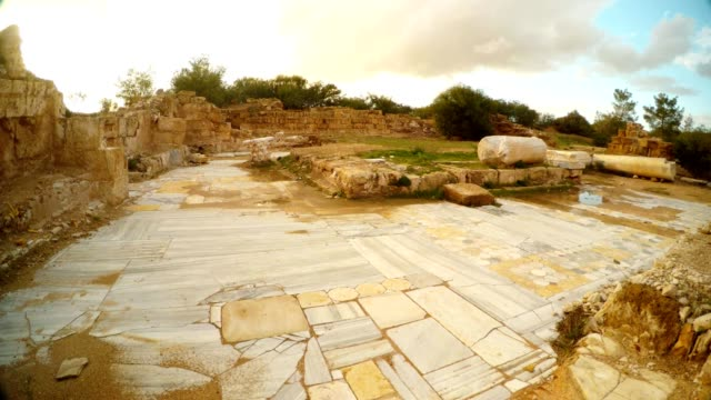 Antique street paved with marble tiles columns on ground ruins Salamis Cyprus video