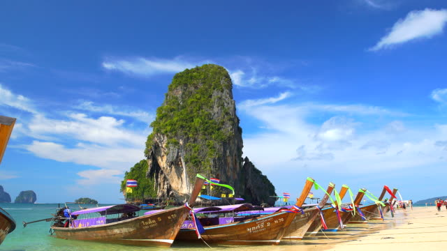 Aonang beach with wooden boats on sea coast video