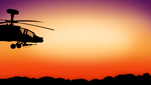 Apache helicopter passing by during sundown HD video