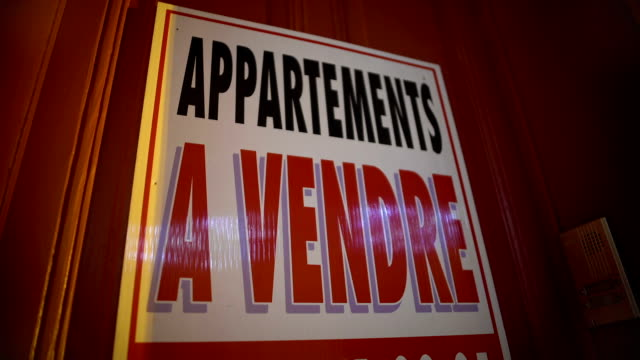 Apartments for sale sign on door, financial crisis, real estate business video
