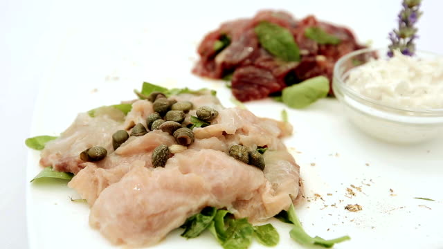 Appetizer of fresh raw tuna and sword fish. Close up. video
